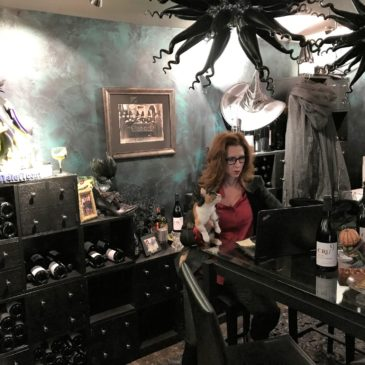 Faythe sits at a desk