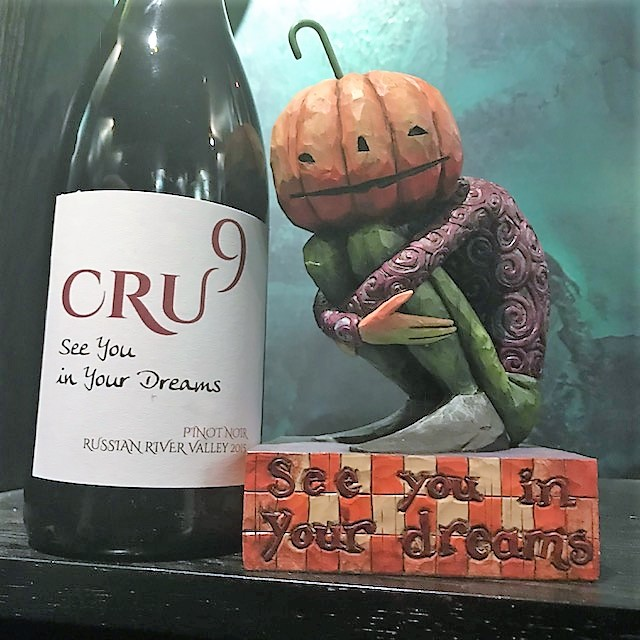 See You In Your Dreams Re-Labeled Pinot bottle sits next to pumpkin statue
